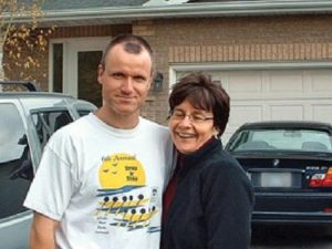 Williams and his wife. Behind Williams is his pathfinder, the vehicle he used to transport the body of Jessica Lloyd.