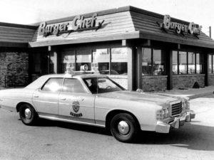 A squad car sits outside the restaurant November 19, 1978